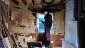 Stripping back the mouldy wall