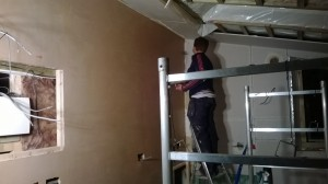 Amy plastering kitchen
